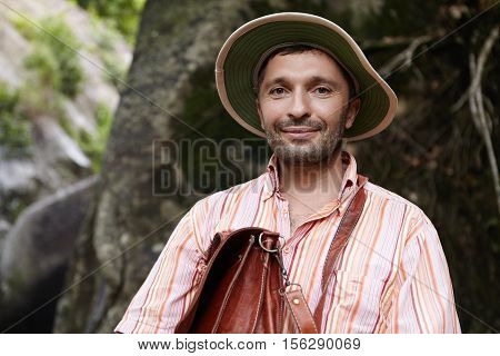 Science, Biology, Ecology And Nature Protection Concept. Outdoor Portrait Of Attractive Smiling Bota