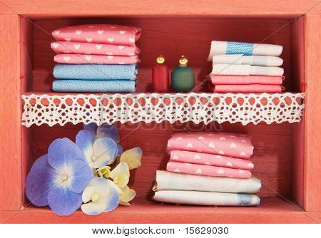linen closet with bottles and flowers in miniature