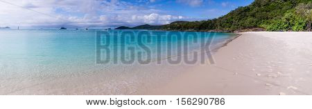 Panorama of Whitehaven beach at Whitsunday Island in Queensland, Australia. Whitehaven beach is a well known landmark known for its beautiful white sand and clear wates.