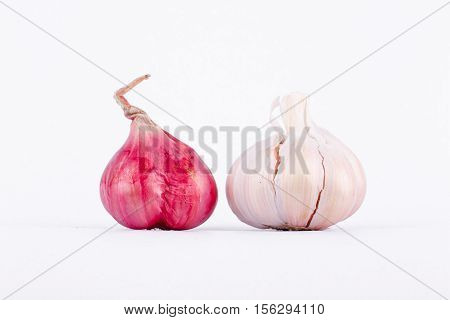 Shallots (Red Onion) and Garlics are popular ingredients in cooking on the white background isolated