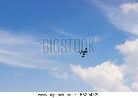 Radio Controlled Toy Airplane Against Blue Sky With White Clouds