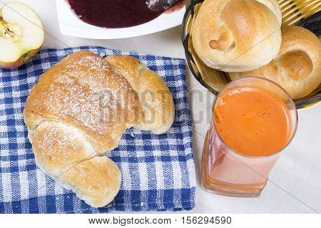 croissant juice bagels and jam breakfast ingredients