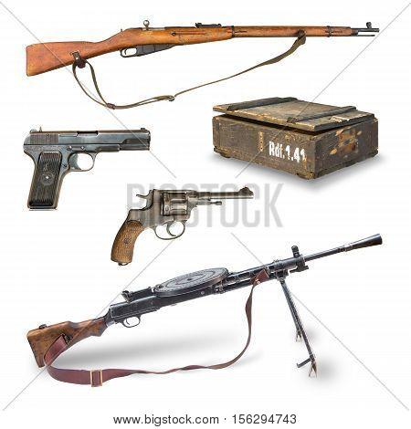 Antique weapons during World War II. pistols rifles machine guns revolver ammunition box.
