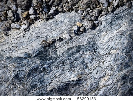 abstract background or texture small pebbles on a rock mica