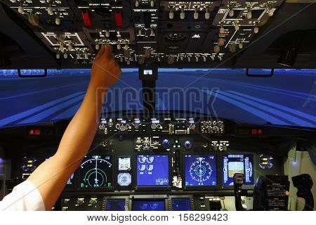 Hand control switch on top board of pilot room in flight simulator