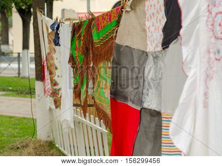 Various colorful shawls in autumn market. Russia