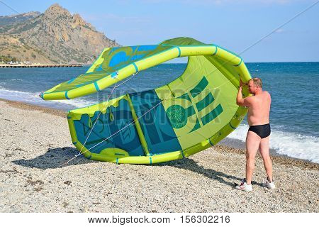Man In A Speedo Launches The Kite On The Beach