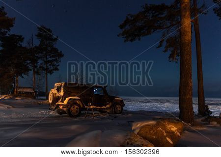 Leningrad Oblast, The Road Of Life, Russia, November 11, 2016. Jeep Wrangler in the background of the Northern lights, the Jeep Wrangler is a compact four wheel drive off road and sport utility vehicle