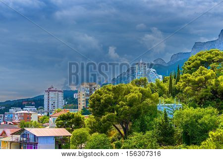 The town in the mountains under the dark sky