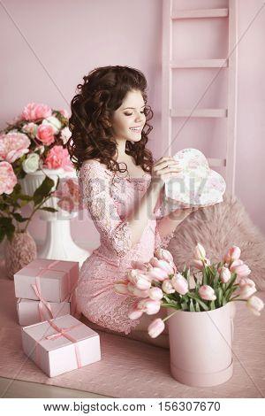 Beautiful Smiling Teen Girl Portrait Open Present, Romantic Surprise. Brunette In Pink Dress Over Bo