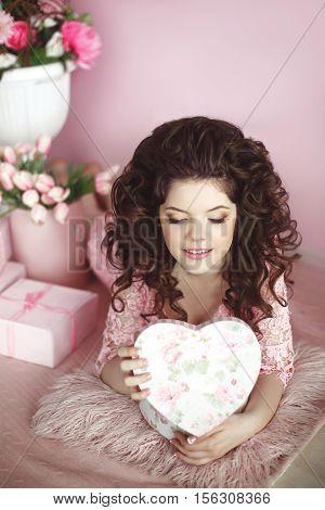 Attractive Smiling Teen Girl Portrait Open Present, Romantic Surprise. Brunette In Pink Dress Over B