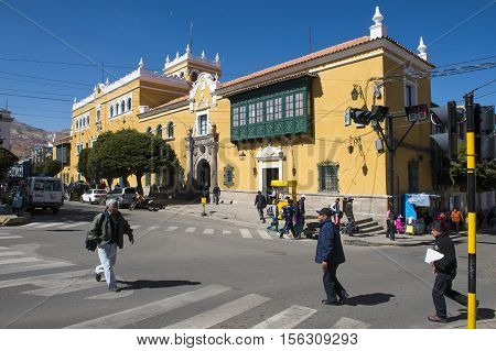 Potosi Bolivia - November 29 2013: People crossing a crosswalk the city of Potosi in Bolivia. Potosi is one of the highest cities in the world and it was the major supply of silver for Spain during the colonial era.