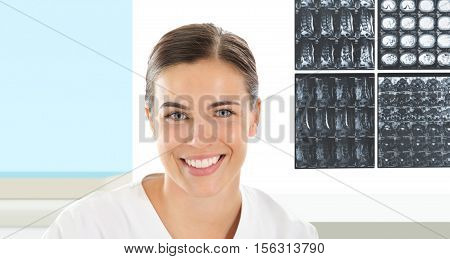 Radiologist woman smiling with xray on background