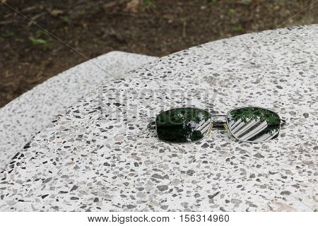 Black sunglasses on Terrazzo floor marble table