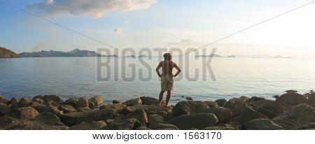 A Man Looking Over The Infinite Tropical Sea And Island Archipelago, Labuan Bajo, Pede Beach, Flores