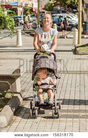 The Woman With The Baby In A Stroller