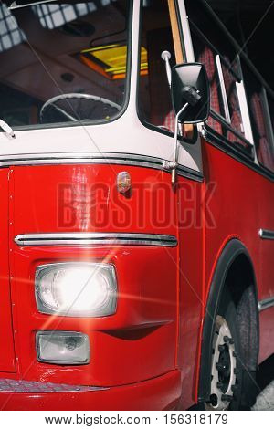 Partly view of red old retro bus.