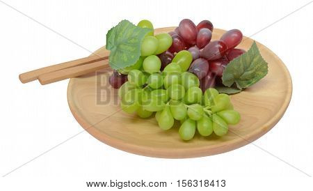 Grape in a wooden plate and wooden column on white background.