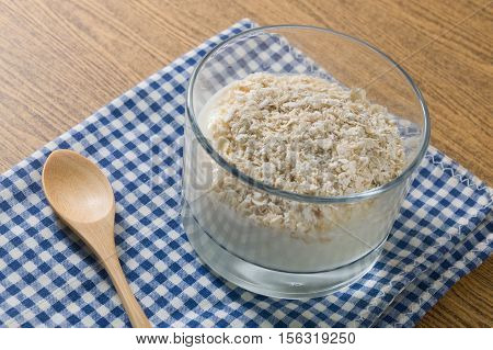 Cup of Homemade Yoghurt Topping with Porridge Oats Nutritionally Rich in Protein Calcium Riboflavin Vitamin B6 and Vitamin B12.