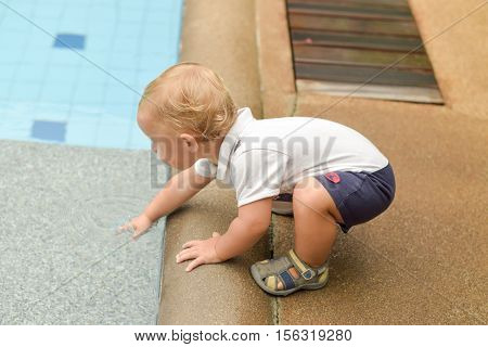 Boy Todler Touch The Water