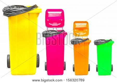 Collection of large colorful trash cans (garbage bins) isolated on white