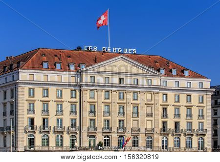 Geneva Switzerland - 24 September 2016: facade of the Four Seasons Hotel des Bergues building. The luxurious Hotel des Bergues has been a landmark on Lake Geneva since 1834.