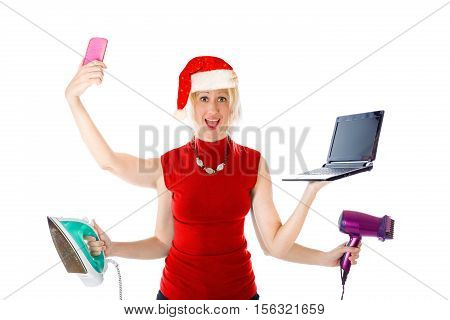 Multitasking Santa Claus woman with Christmas technologic gifts, about mobile phones, computers, appliances and electronic beauty tools on white background.