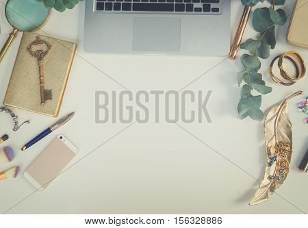 Laptop keyboard with golden woman accessories and green plants mock up flat lay styled scene, top view, copy space on white table background, retro toned