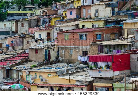 Colorful illegal houses of the poor inhabitants of Luanda Angola. These ghettos resemble Brasilian favelas.