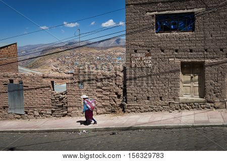 Potosi Bolivia - November 29 2013: Woman wearing traditional clothes in the city of Potosi in Bolivia. Potosi is one of the highest cities in the world and it was the major supply of silver for Spain during the colonial era.