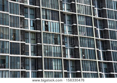 Building image : Condo windows and balconies viewed