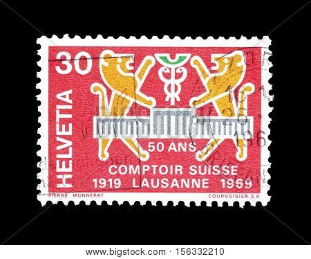 SWITZERLAND - CIRCA 1969 : Cancelled postage stamp printed by Switzerland, that shows Two lions and Comptoir badge.