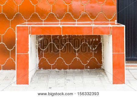 Distinctive orange tile bench and wall in Cozumel Mexico