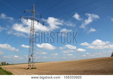 Transmission line on background of blue sky.