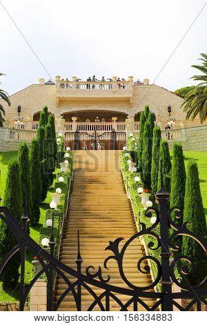 HAIFA ISRAEL - CIRCA SEP 2016: Bahai gardens terrace with tourists green trees and gates.