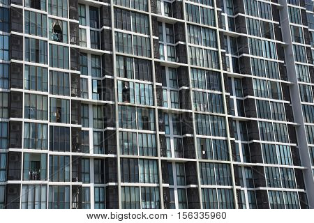 Building Background : Condo windows and balconies viewed