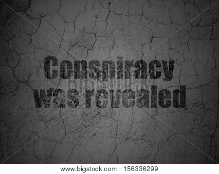 Political concept: Black Conspiracy Was Revealed on grunge textured concrete wall background