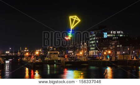 Amsterdam Netherlands - December 18 2015: Light Festival Amsterdam neon light kite above the port of Amsterdam