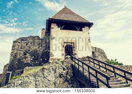 Ruin castle of Visegrad Hungary. Ancient architecture with stairs. Travel destination. Cultural heritage. Retro photo filter.