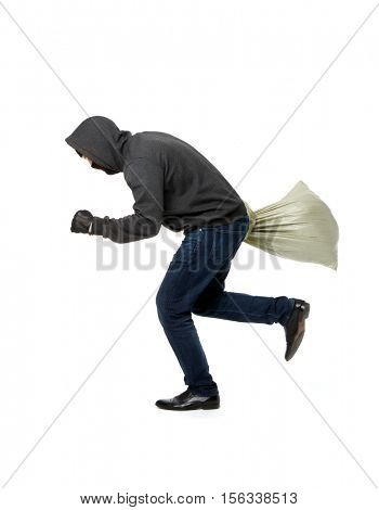 Thief flees with gray sack