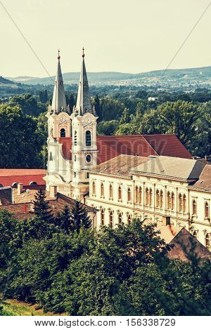 Saint Ignatius church view from Esztergom basilica Hungary. Travel destination. Cultural heritage. Urban scene. Retro photo filter. Religious architecture. Danube river.