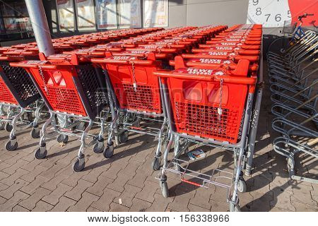 BURG / GERMANY - NOVEMBER 13 2016: Shopping carts of the german supermarket chain REWE stands together in a row. The REWE Group is a German diversified retail and tourism co-operative group.