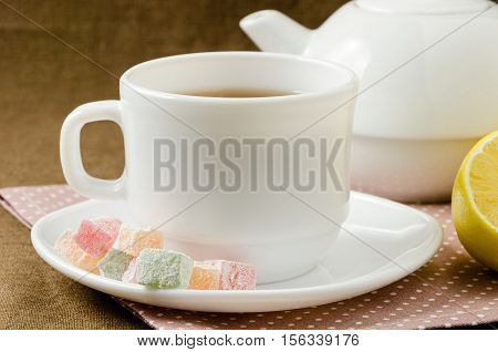 Turkish delight with tea on a saucer, breakfast concept
