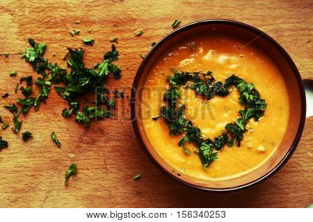 pumpkin smashed soup with parsley dill heart