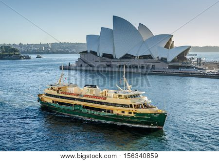 SIDNEY - AUSTRALIA NOVEMBER 2, 2016: A passenger ferry passes in front of the Sidney Opera House, a multi-venue performing arts center, designed by Danish architect Jorn Utzon.