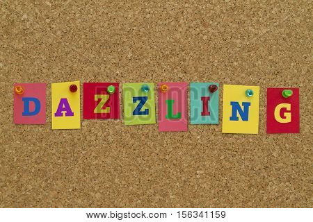 Dazzling word written on colorful sticky notes pinned on cork board.