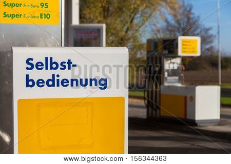 BURG / GERMANY - NOVEMBER 13 2016: Shell gas station sign self-service ( Selbstbedienung) Shell is an Anglo-Dutch multinational oil and gas company headquartered in the Netherlands.