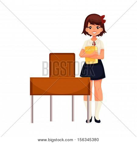 Clever school girl standing at the desk and holding a book, cartoon vector illustration isolated on white background. Full height portrait of pretty girl in school uniform standing at the desk