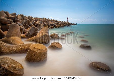 Beautiful waves breaker seascape scenery during mid day on sea shore at Terengganu Malaysia.Soft focus during long exposure shoot.
