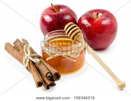 honey pot cinnamon and red apple on an isolated white background, rope